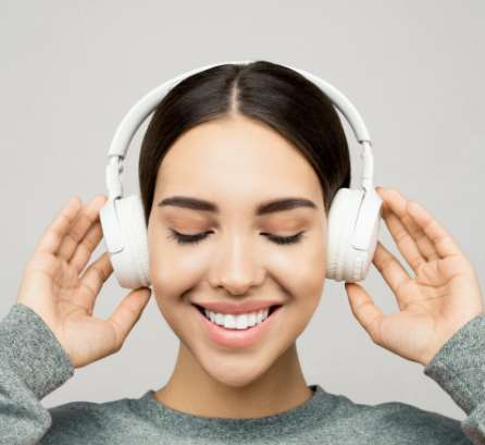 A picture showing a girl wearing Bluetooth headphones