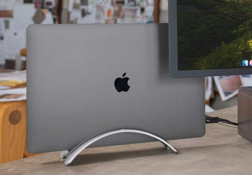 Macbook in clamshell mode in a vertical stand